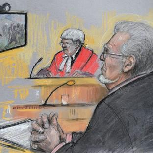 This Is Lancashire: Court artist sketch of Rolf Harris being shown footage of a TV game show in which he appeared during the 1970s