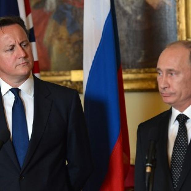 This Is Lancashire: Prime Minister David Cameron and Russian President Vladimir Putin are to hold face-to-face talks on the Ukraine crisis