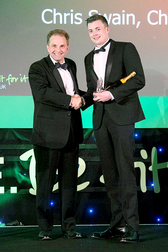 WELL DONE: Chris Swain, right, receiving his award from David Lloyd Leisure's group property director Paul Guyer