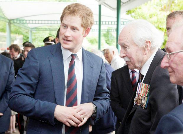 Dennis Walton with Prince Harry and Jack Dixon, right