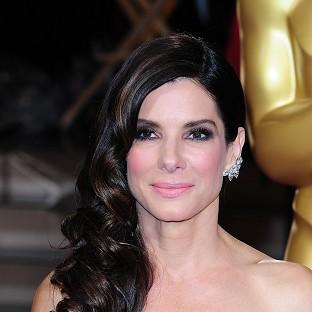 This Is Lancashire: Sandra Bullock was at home as a burglar was arrested by police