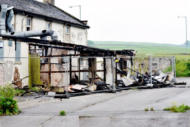 The aftermath of the fire at the back of the Burnley Road premises