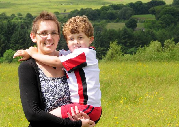 This Is Lancashire: Brave Rowena and her son Freddie