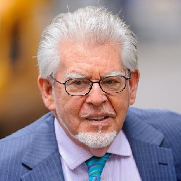 This Is Lancashire: Rolf Harris denies all charges.