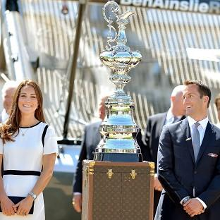 This Is Lancashire: The Duchess of Cambridge with Sir Ben Ainslie in front of the America's Cup during a visit to the National Maritime Museum, London
