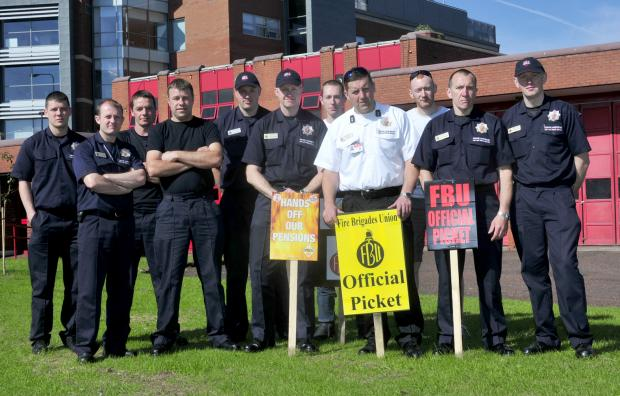 This Is Lancashire: Bolton's firefighters begin their 24-hour strike