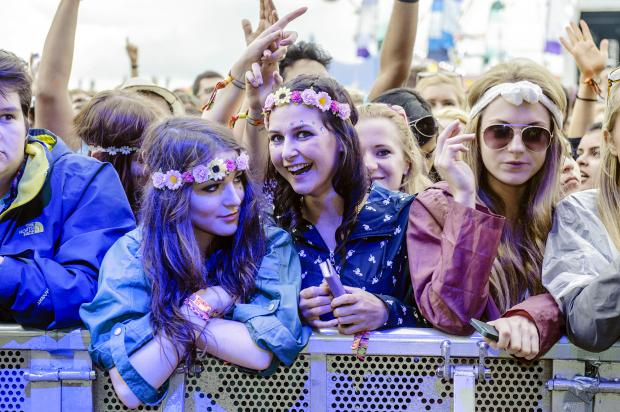 This Is Lancashire: Music fans brought a touch of flower power to the festival, but it was marred by violence