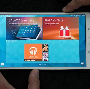 This Is Lancashire: Samsung unveil their new Galaxy Tab S 8.4 inch model at Canary Wharf in London.