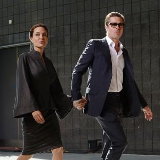 Angelina Jolie and Brad Pitt arrived hand-in-hand for the London summit