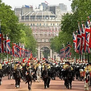 This Is Lancashire: Troops from the Household Cavalry march along the Mall to Buckingham Palace following the Trooping the Colour ceremony