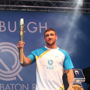 This Is Lancashire: Alex Arthur carried the Glasgow 2014 Queen's Baton on to the stage as it ended the day in Edinburgh (David Cheskin for Glasgow 2014)