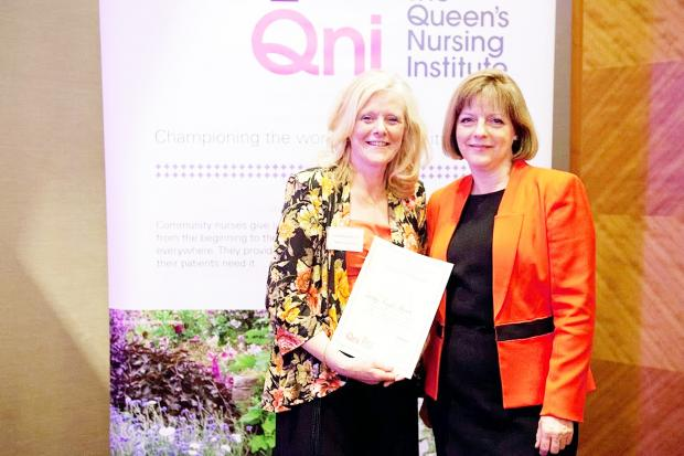 This Is Lancashire: Lesley Royle-Pryor receives the award from Jane Cummings