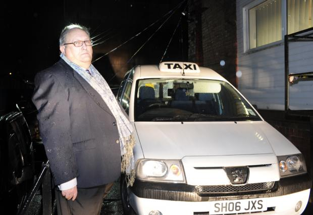 Taxi driver Charlie Oakes and his white car