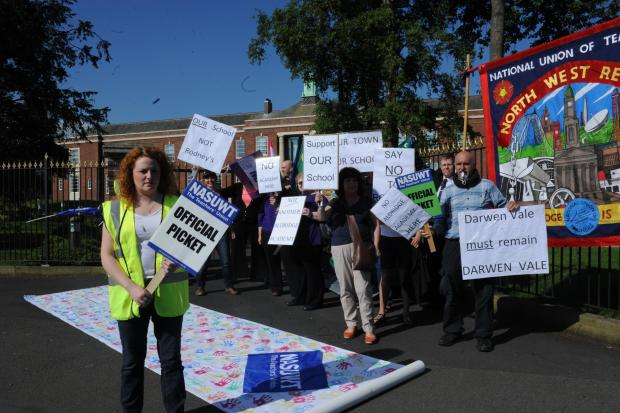 Members of the National Union of Teachers and National Union of Schoolmasters Union of Women Teachers were joined by concerned parents on the picket line