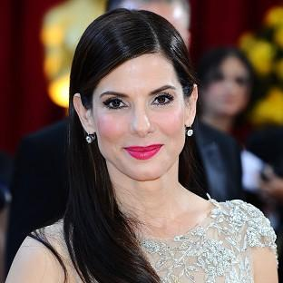A man accused of breaking into Sandra Bullock's home is also facing a raft of weapons charges