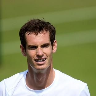 Andy Murray smiles during his practice session at Wimbledon
