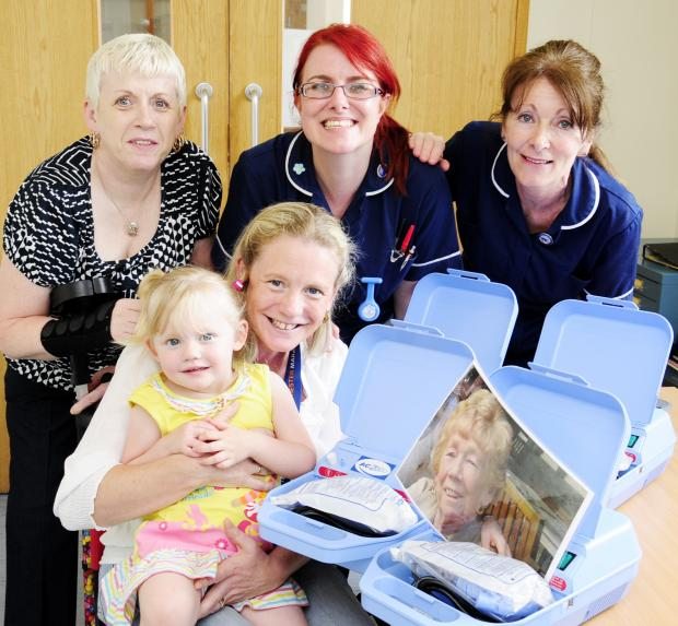 From back left, Sandra Black, ward sister Mandy Chesney and ward sister Denise Knowles, front, Joanne Wells with daughter Olivia