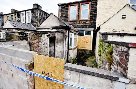 The boarded up house where the arson attacks took place