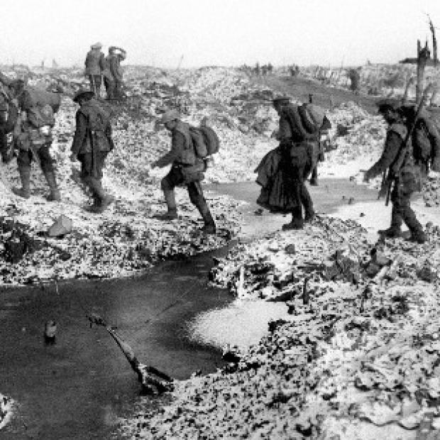 This Is Lancashire: British soldiers negotiating a shell-cratered landscape in 1916