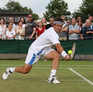 This Is Lancashire: Pat Cash in action at Wimbledon in 2010 wearing his trademark headband