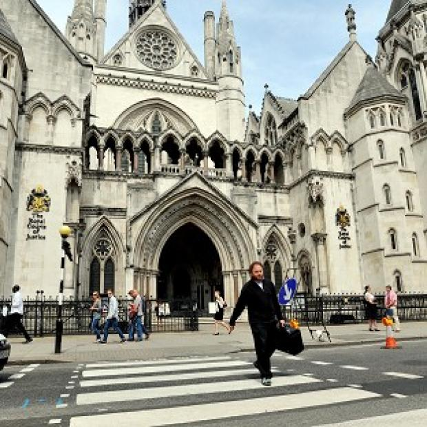 This Is Lancashire: The couple became embroiled in a transcontinental tug-of-love over their baby daughter, a High Court judge heard