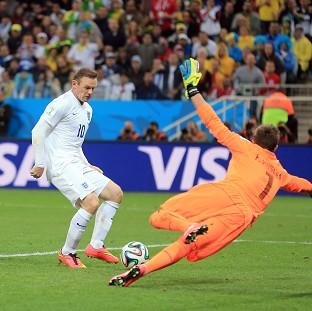 Wayne Rooney scoring for England in the Uruguay match