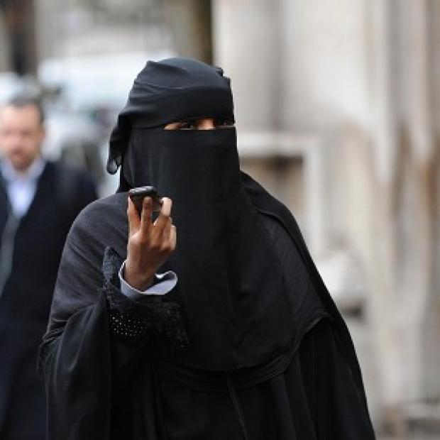 This Is Lancashire: A woman wears a burka in London