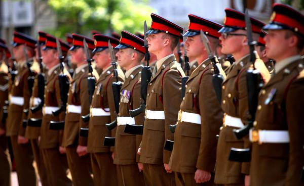 This Is Lancashire: Thousands line the streets of Accrington for military parade