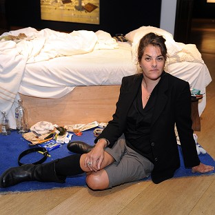 Artist Tracey Emin during a photocall with her piece My Bed.
