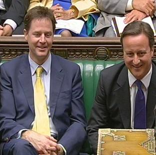Deputy Prime Minister Nick Clegg sits next to David Cameron at Prime Minister's Questions in the House of Commons