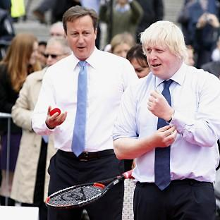 A Russian banker has won an auction to play tennis with David Cameron and Boris Johnson