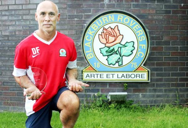 Blackburn Rovers physio Dave Fevre with his awards