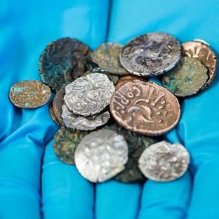 A hoard of Roman and Late Iron Age coins which were discovered in