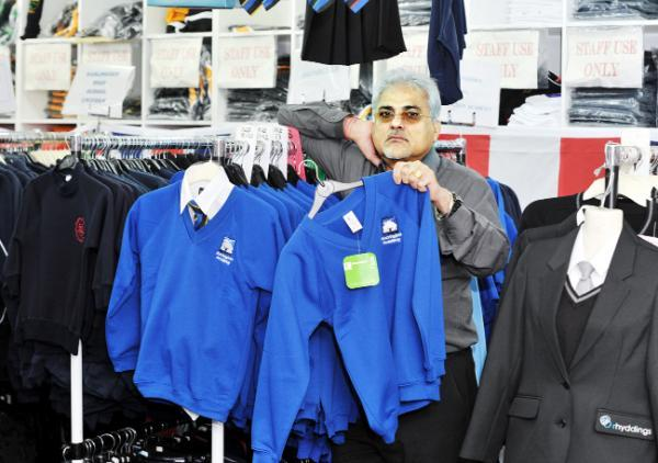Shop owner Rohni Vij with the outdated Accrington Academy schoolwear