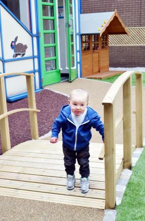Anthony Jack ventures over the bridge in the new sensory garden at Burnley General Hospital