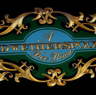 This Is Lancashire: A JD Wetherspoon logo, as the pub chain is to cut the opening times of its outlets at the weekends in response to late-night levies being introduced by local councils