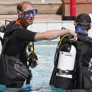 This Is Lancashire: The Duke of Cambridge makes safety checks with BSAC chairman Eugene Farrell before scuba diving with British Sub-Aqua Club members at a swimming pool in London