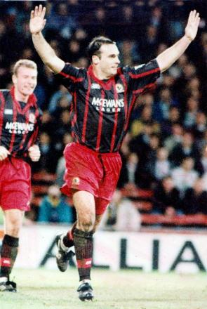 Mark Atkins celebrates a goal for Rovers