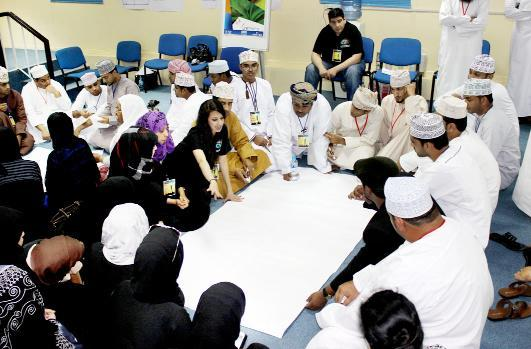 Students talk to volunteers in Oman