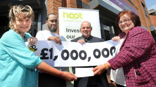 At the cheque presentation, from left, are, Karen Minnitt, chief executive Bolton CVS, Ibrahim Ismail, chairman Bolton CVS, Bob Beedham, Hoot director,  and Chris Canham, Hoot assistant manager