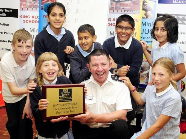 Paul McGoven, from The Prison Service, with pupils Emily Hinds, front left, and Chantelle Bird. Back, from left,  Malacki Fearnley, Noor Nawaz, Rishal Patel, Amaan Khan and Alisha Issa