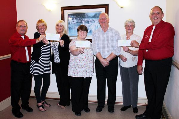 Fundraisers, from left, Ian Ackerley, Gill Johnson, Jane Haslam, Denise, Ernie Holden, Jean Smith and Martin Carlile