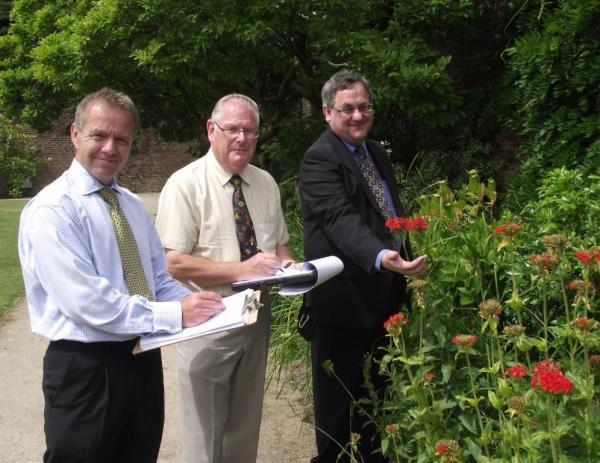 HELLO PETAL Councillor Adrian Lowe, right, shows off blooms in Astley Park's walled garden to North West in Bloom judges Graham Jones and Brian Whalley