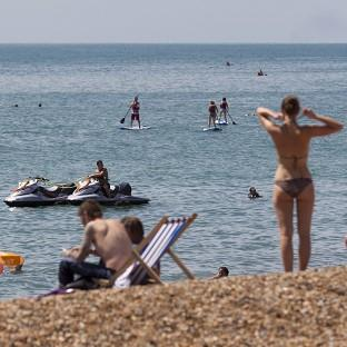 People flock to the beach in Brighton, East Sussex, as temperat