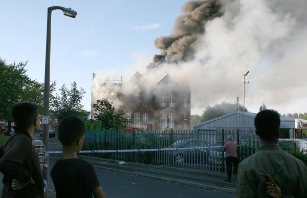 Nearby residents watch as the former Clarendon Primary School burns.