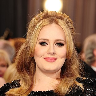Singer Adele, whose young son has been awarded damages for breach of privacy by paparazzi