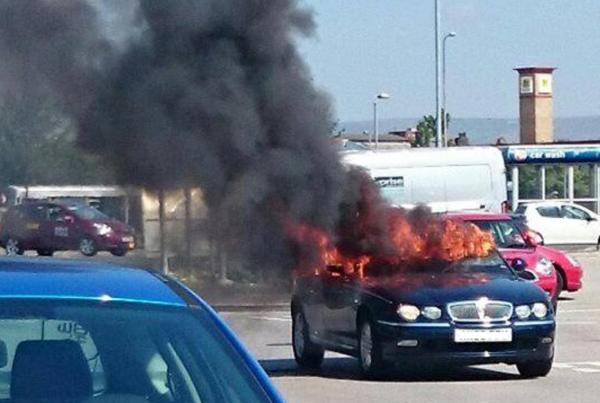 UPDATED: Driver burned as car catches fire in Sainsbury's car park