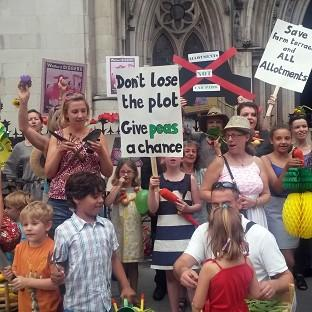 A group of allotment holders protest outside the Royal Courts of Justice over a ruling allowing Watford Borough Council to build over an area of gardens (PA)