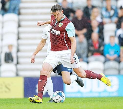 Lukas Jutkiewicz finds the net for Burnley in their 2-1 defeat to Preston last night Picture: ANDY FORD