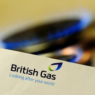 Profits at British Gas fell 26% to £265 million as earnings were dented by mild weather